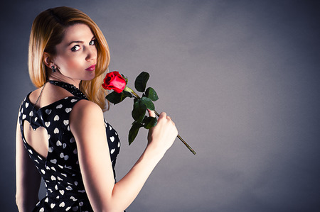 beautiful woman with a flower in hand photo