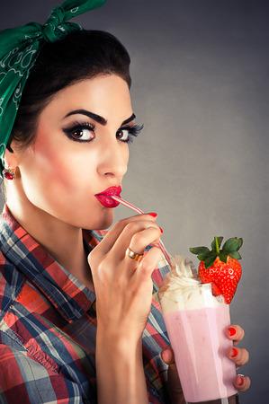 portrait of beautiful fashionable woman in retro style photo