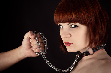 bondage girl: portrait of a beautiful woman on a leash Stock Photo