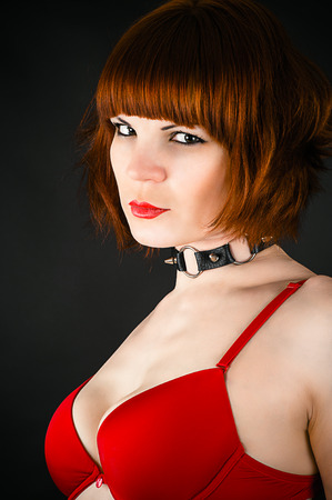 portrait of a beautiful woman with a collar on the neck photo