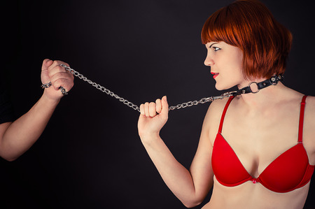 beautiful woman in the role of a slave on a leash Stock Photo