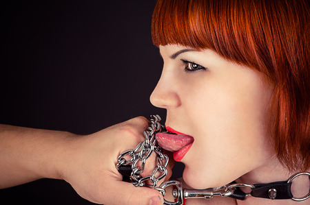 beautiful woman as obedient slaves photo