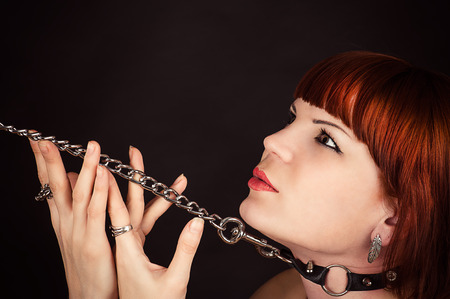 beautiful woman in the role of a slave on a leash photo