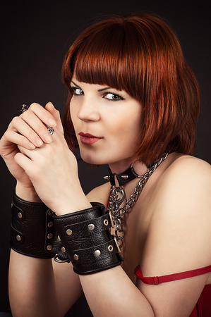 beautiful brown-haired woman in handcuffs Stock Photo