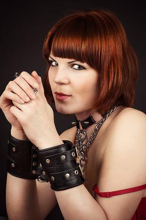 sadistic: beautiful brown-haired woman in handcuffs Stock Photo
