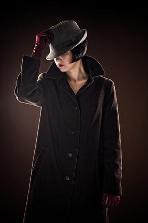 beautiful fashionable woman detective photo