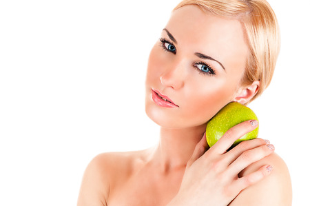 Beautiful healthy woman with apple Healthy eating concept photo