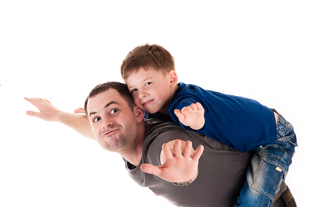 happy father and son flying photo