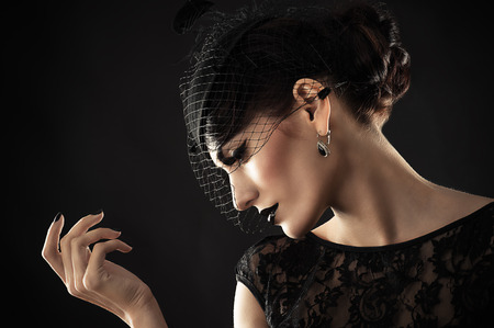 beautiful profile of retro woman with black makeup photo