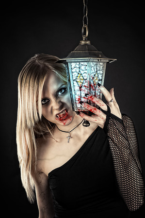vampire with bloody fangs and hands photo