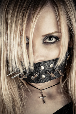 bdsm: portrait of a slave in BDSM theme gagged of thorns Stock Photo