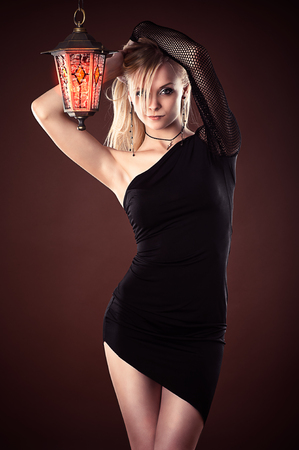 beautiful sexy woman black dress with a lantern photo