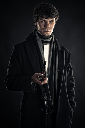young man in the image of Sherlock isolated on black photo
