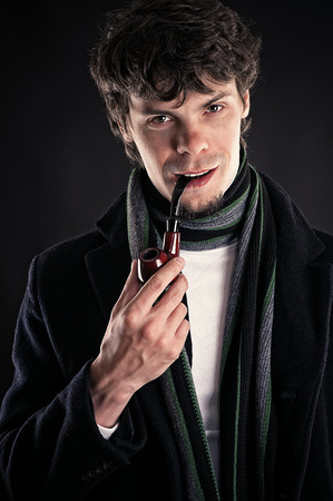 intelligent man with a pipe in a mouth photo