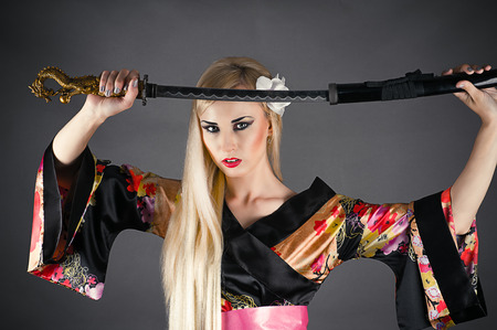 cute woman draws her sword photo