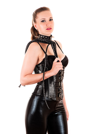 beautiful woman with a whip in hand as mistress photo