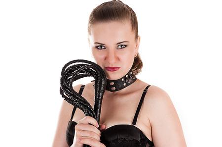 mistress: donna sexy nel ruolo di amante con una frusta in mano