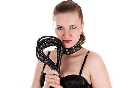 mistress: sexy woman in the role of mistress with a whip in hand