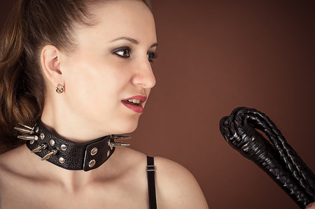 mistress: Portrait of mistress with a whip Stock Photo