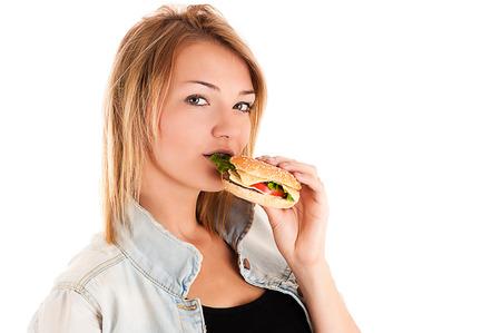 beautiful woman eating a hamburger photo