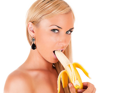 banana skin: beautiful blond woman sexy eats banana