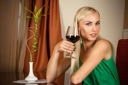beautiful girl sitting with a glass of wine photo