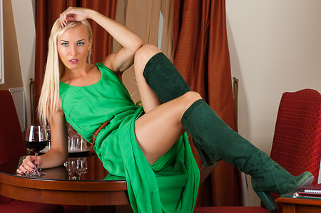 fashion woman in a green dress with a wine glass photo