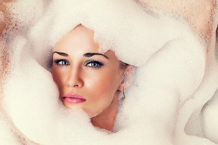 art portrait of a beautiful blond woman in the foam photo