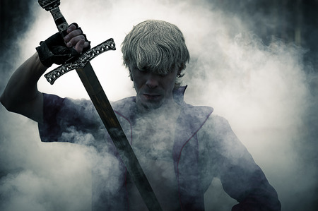 fantasy forest: portrait of a brutal warrior with sword in smoke