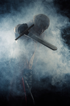 brutal man hit a sword in smoke photo
