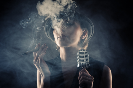 jazz singer: jazz singer woman with cigar and microphone Stock Photo