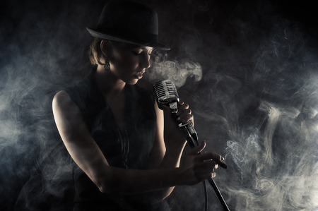 smoking girl: jazz singer woman with retro microphone