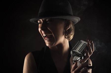 retro microphone: smiling jazz singer with retro microphone