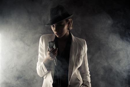 retro microphone: fashion woman with retro microphone in smoke