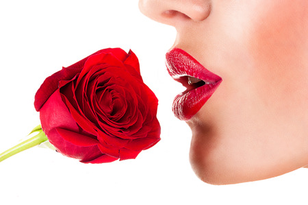 sexy woman smelling flower, sensual red lips Archivio Fotografico