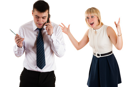 workaholic: workaholic businessman and angry wife Stock Photo