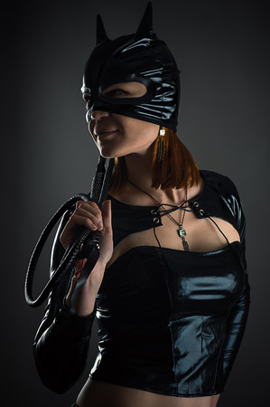 beautiful bdsm: portrait cat woman with a whip in hand