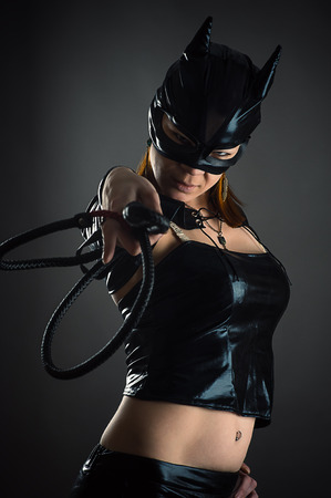 woman cat with a whip in hand Stock Photo