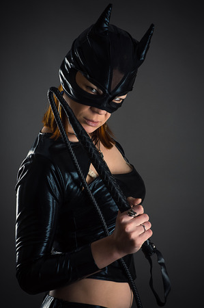 woman cat with whip Stock Photo