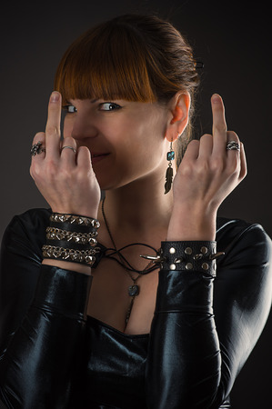 indecent: woman showing middle fingers Stock Photo