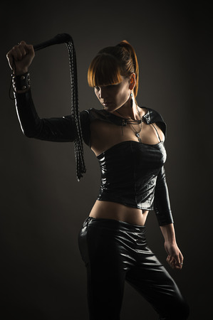 sexy woman with whip in hand