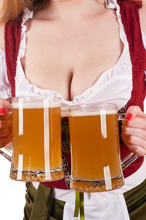 big breasts Oktoberfest waitress with two mugs of beer Zdjęcie Seryjne - 36891290