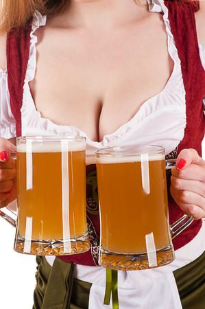big breasts Oktoberfest waitress with two mugs of beer Archivio Fotografico