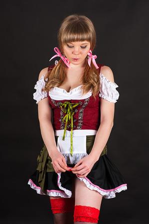 shyness: modest sexy woman Oktoberfest Stock Photo