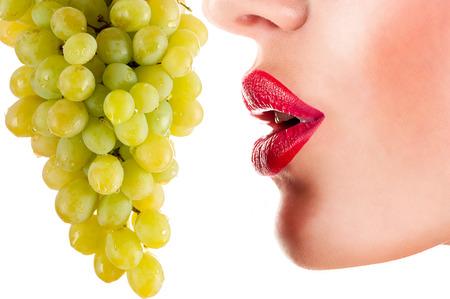 sexy woman eating green grapes, sensual red lips