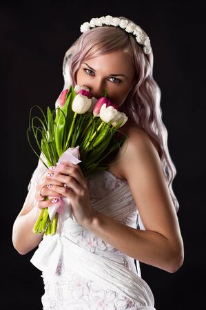 smelling: bride in wedding dress smelling wedding bouquet Stock Photo
