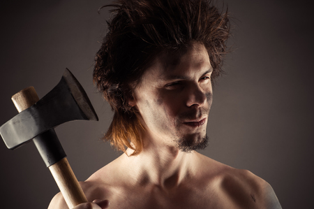 ax man: portrait of unshaven man with an ax in hand