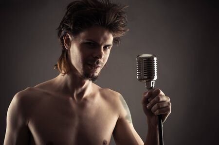 retro microphone: young singer with retro microphone Stock Photo