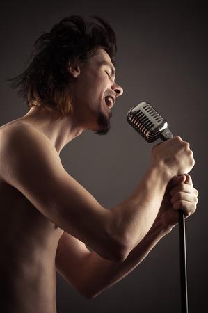 retro microphone: singer singing into retro microphone