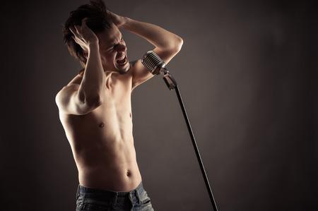 retro microphone: emotional singer singing into retro microphone